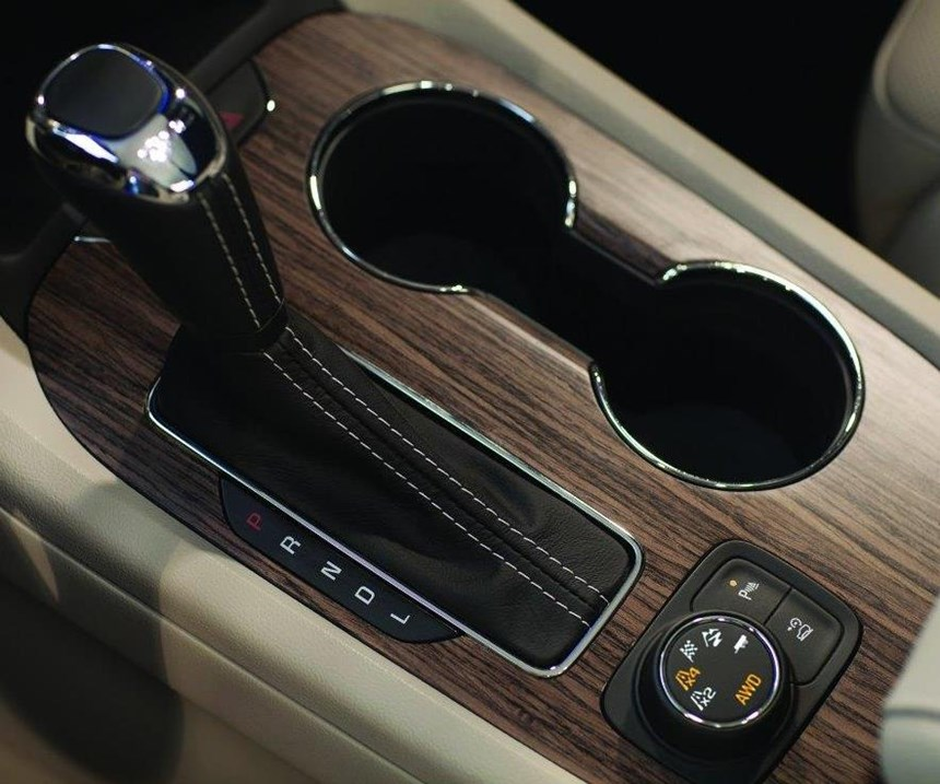 The Acadia offers a drive mode selector (just below the gear selector) that tailors chassis and powertrain settings for various driving conditions. The front-drive vehicles have Normal, Snow, Sport and Trailer/Tow modes; AWD models offer 2 x 4 (AWD disconnect), 4 x 4, Sport, Off Road and Trailer/Tow.