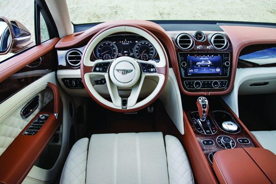 The plush interior features an upgraded infotainment system and premium materials.