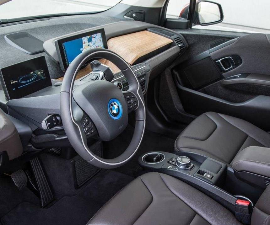 The instrument panel for the BMW i3 plug-in hybrid features unpainted eucalyptus wood trim.