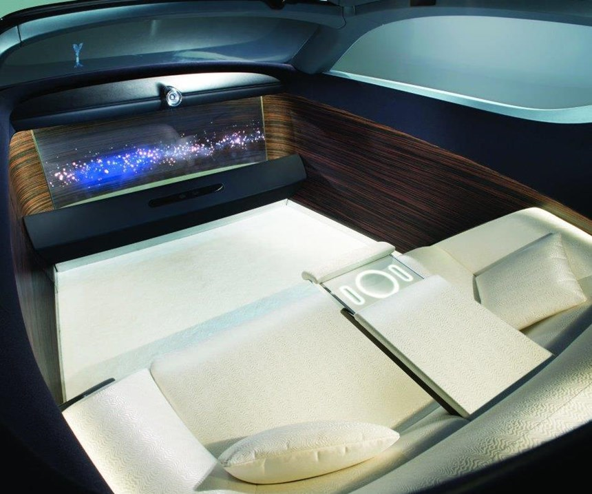 The VISION NEXT 100 is autonomous, so the occupant space foregoes traditional seats and puts in a sofa, with extra room inside because there is no need to have a spot for the chauffer.