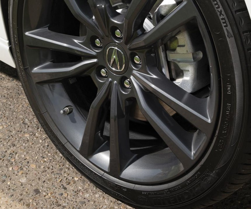 To get a clean look for the wheel arches, a roll-hemming process is used in place of traditional spot welds. By using hemming to join the inner and outer fender sheet metal on the inside of the fender opening, there are no visible spots. They're also able to achieve a reduced tire-to-fender gap.