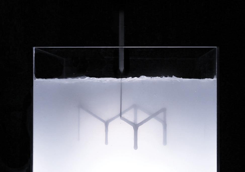 """A demonstration of rapid liquid printing, in which parts are """"drawn"""" using a robotic arm, eliminates the need for layering or curing. The object is a table top designed by Steelcase."""