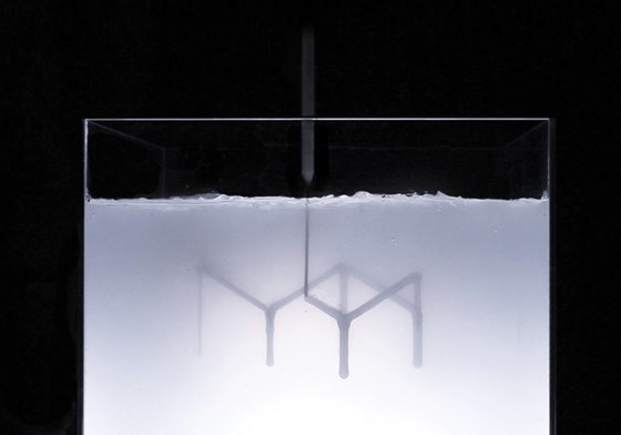 "A demonstration of rapid liquid printing, in which parts are ""drawn"" using a robotic arm, eliminates the need for layering or curing. The object is a table top designed by Steelcase."