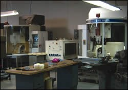 One filtration system servicing two precision grinding machines