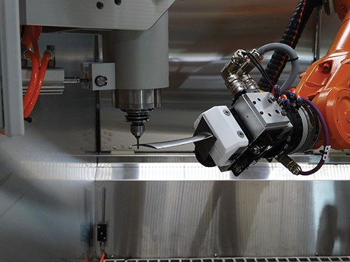 robot holds turbine blade