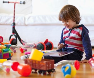 child with plastic toys