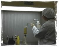 Technician rinses a part