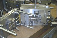 Complicated, multiple action automotive mold application