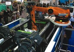 A robot mounted to an injection molding machine