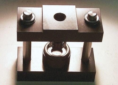 ASTM C 1499 test fixture