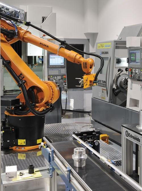 Robot tending a multi-process machine