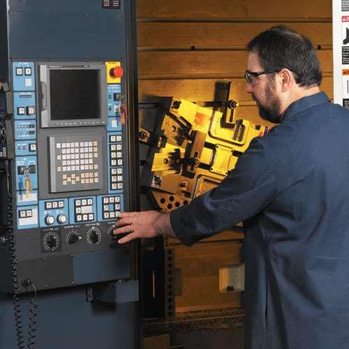 A CS Tool employee operates the Makino.