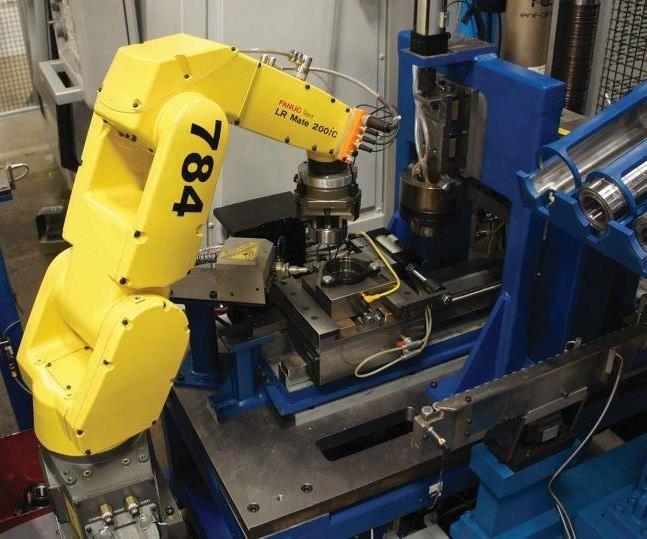 robot picks up part