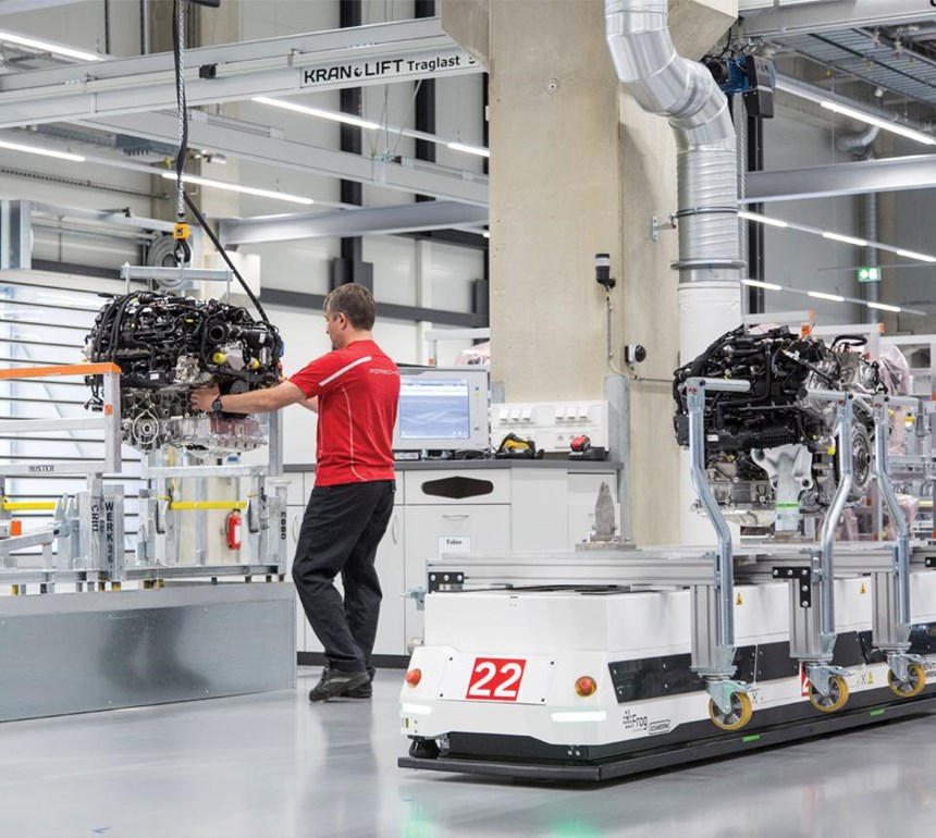 The electric transport vehicles are guided by magnets embedded in the factory floor.