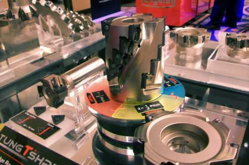 This TungTriShred flute mill on display at Tungaloy's product seminar is equipped with chip-splitting inserts whose wavy edges break chips and reduce machining load.