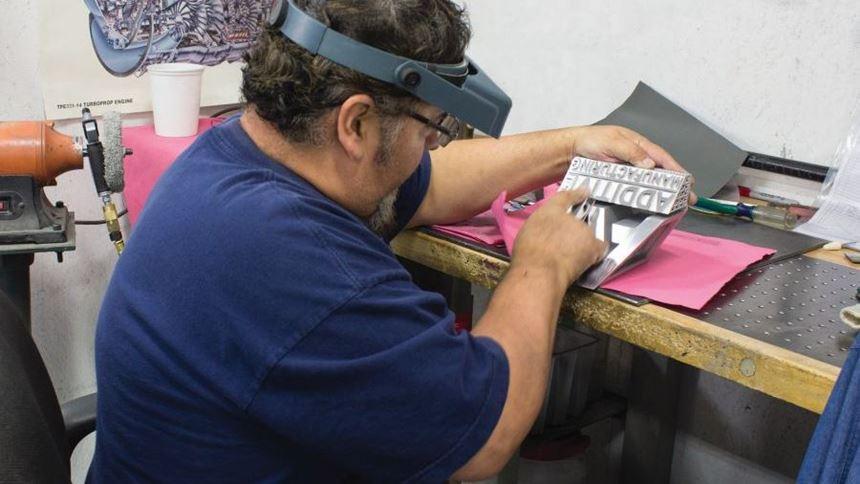 an employee finishing the part