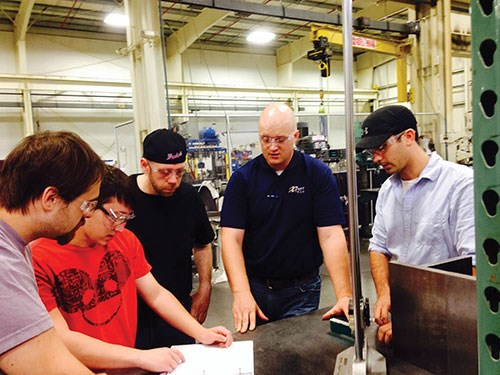 Ryan Pohl instructing maufacturing students