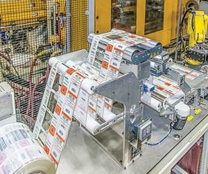 precut roll fed IML system
