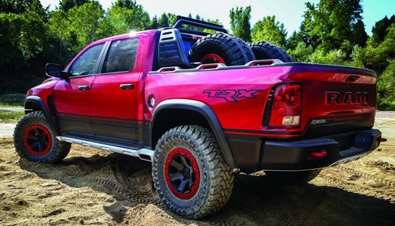 When you're designing a vehicle for serious off-roading, you take into account the likelihood of the tires getting thoroughly chewed by rocks, so the Rebel TRX concept is designed to carry two spare tire and wheel packages, including the tools in a lockable box in the back.