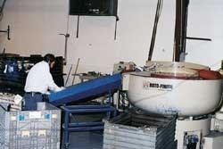 One of four vibratory finishing machines