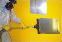 squeegee into the vacuum system