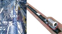 A composite carrier mat with embedded sensors is used to monitor bending strains in a metallic riser system.