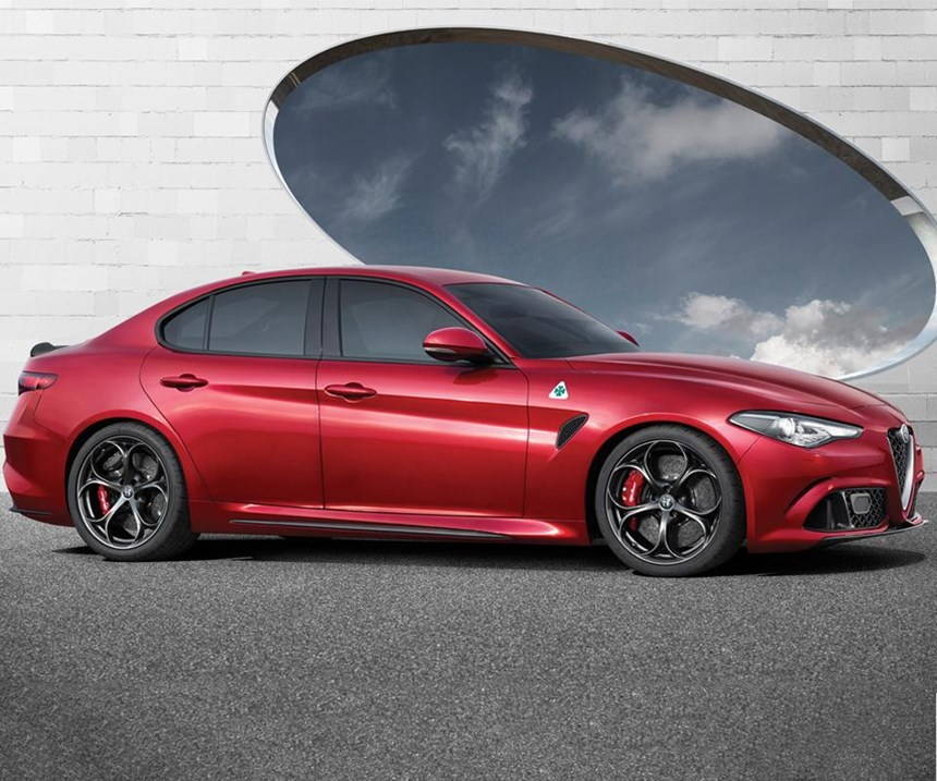 """The Alfa Romeo Giulia Quadrifoglio. Which is, roughly speaking, Italian for """"really fast sedan."""" It lapped the Nurburgring in 7 minutes, 32 seconds, which set a record for a production midsize sedan. What's more, it even has a trunk that you can put the groceries in."""