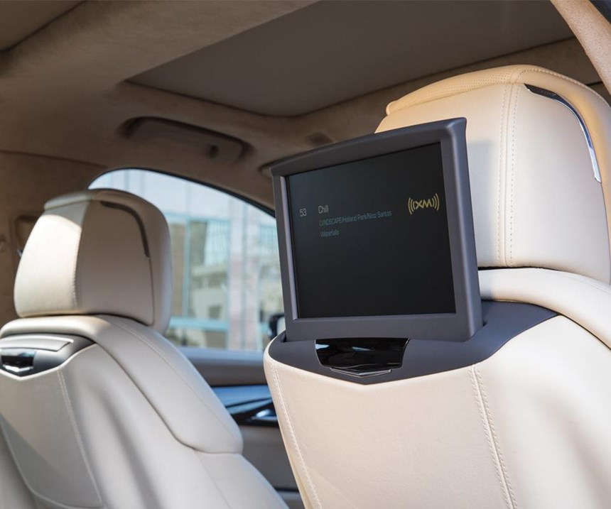 Ten-inch screens for the rear passengers in the Cadillac CT6 leverage the 4G LTE Wi-Fi hotspot capability in the luxury sedan. They descend into the seatbacks when not being used.