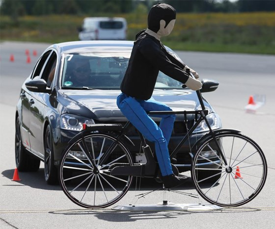 Low cost Automatic Emergency Braking System fuses information from the radar unit of a base AEB unit with a wide field of view camera in order to detect and track cyclists traveling to the vehicle or crossing its path in order to meet 2018 Euro NCAP standards.