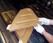 A technician removes a molded rib.