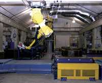 NCC's computer-controlled Large Scale Preformer has a processing envelope big enough to produce preforms as large as 40 ft by 14 ft by 8 ft high.