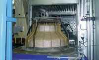 Step 4: The preform enters a heated oven, where the binder is melted and consolidated with the fiber at 149°C/300°F.