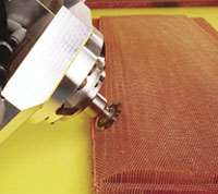 Six -axis ultrasonic cutter incorporates a disc to sculpt  honeycomb air foil shape.