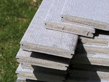 Extruded, wood-reinforced thermoplastic building material requires no paint or preservatives and is impervious to rot and insect damage.