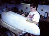 Step 8: Seams are covered with body filler and the body is sanded, in preparation for painting.