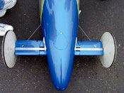Step 9: Airfoils are installed over the axles and the vehicle is painted.