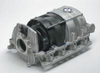 Cutaway of manifold assembly showing phenolic composite rotors and internal housing, supported in magnesium external housing.