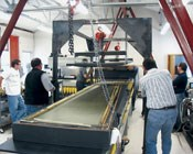 The top of the RTM mold is lifted away from the molded flap. Note that the mold weight requires lifting infrastructure.