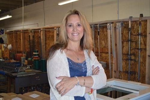 Kim Bossley standing in her shop