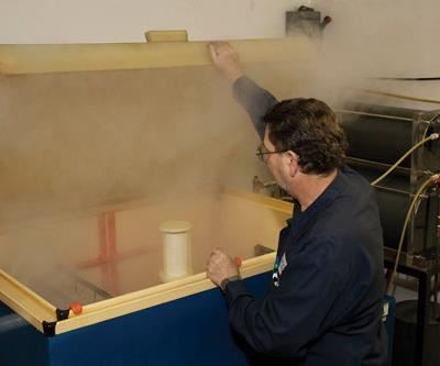 Salt-spray fog disperses when the chamber is opened.  Photo courtesy of H.E. Orr Co.
