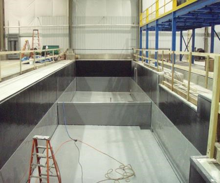 Techniques have been developed to detect leaks in double walled and/or bottom tanks.