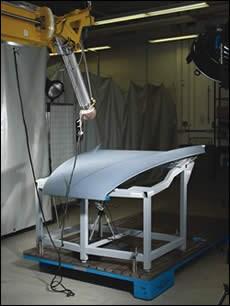 Carbon-fiber/epoxy hood assembly