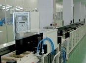 Step 6: Profiles are automatically inspected for integrity in a water-immersion, pulse-echo-type ultrasonic station.