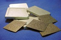 Highly oriented pyrolytic graphite (HOPG) sheets can be embedded in AlSiC lids to increase thermal conductivity.