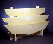 Economical polyurethane foam is often specified for boat transoms that do not take heavy fatigue load cycles.