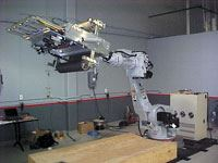 Motoman UP200 robot with 610-mm/24-inch PFE, set up for prepreg material (system shown with arm partially extended).