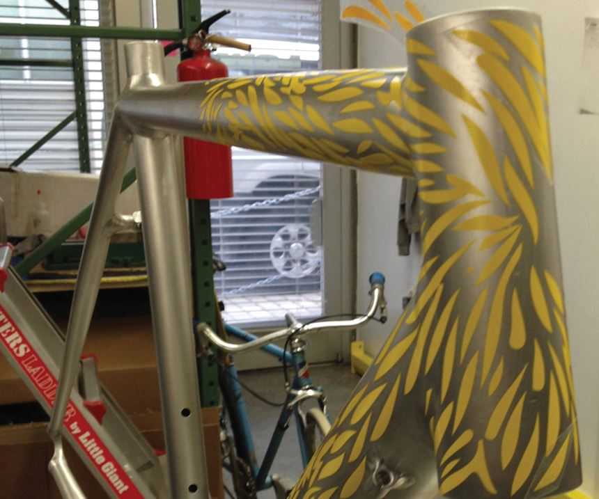 Low uses Mylar-like material for the decals and masking, which often requires several steps in the powder coating process.