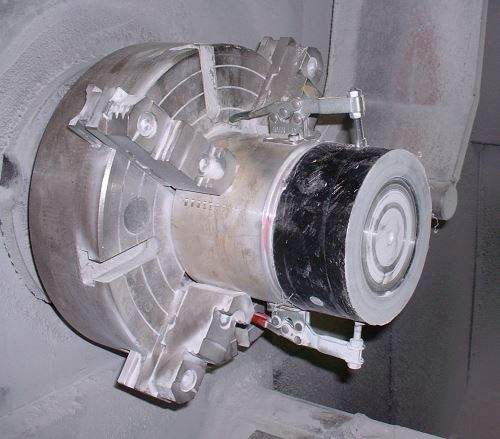 part clamped to header