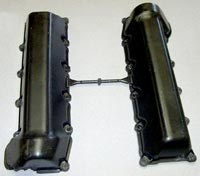 The BMC valve covers are molded in dual-cavity molds, with gating centered along the upper edge as mounted on the engine.