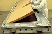 Step 5: Layup of a C-17 spoiler occurs in a large wheeled tool.